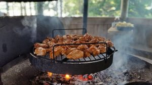 chicken wings on a portable barbeque